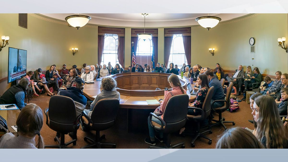 Crowded meeting room at an Assembly hearing in the state Capitol on March 3, 2021