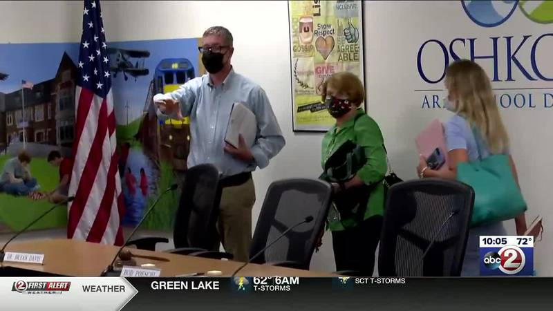 Oshkosh school board members walk out when opponents to a mask requirement in schools refuse to...