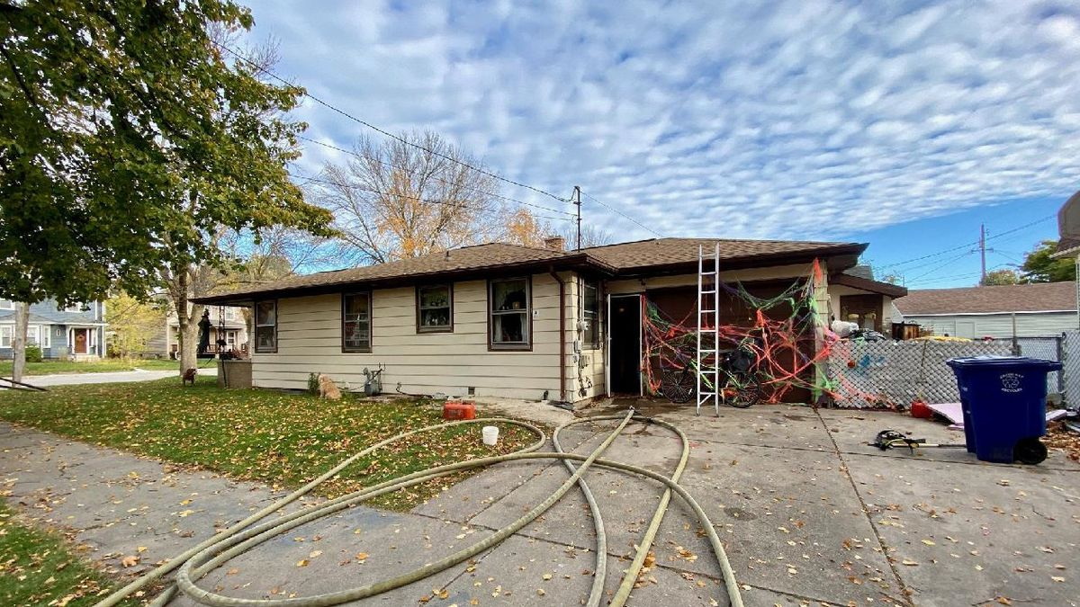 Crews investigate a garage fire in the 400 block of N Ashland in Green Bay. Oct. 19, 2020.