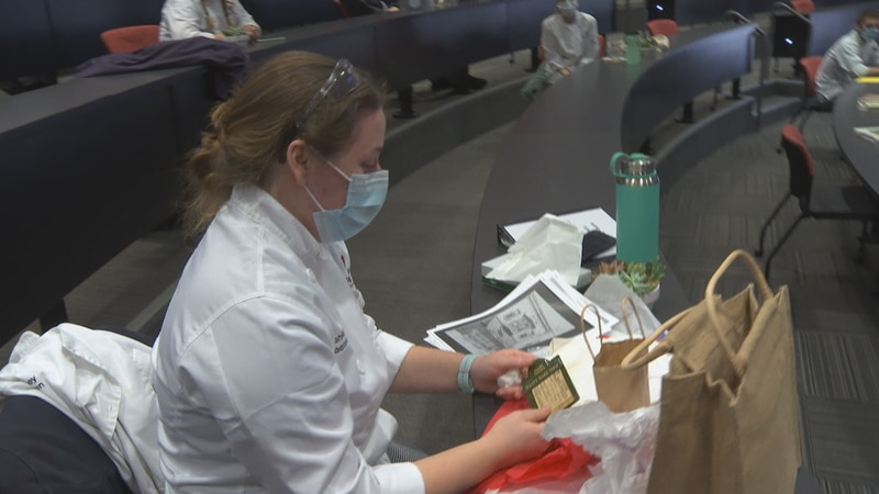 Fox Valley Technical College culinary student Ashley Baeten is surprised to receive items from...