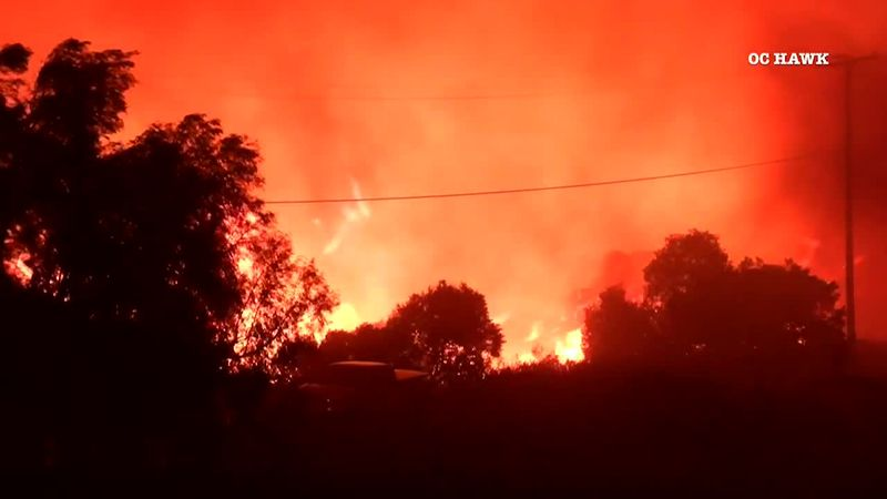 Wildfire causes evacuations in southern California. (Source: OC Hawk via CNN Newsource)
