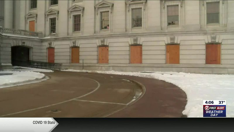 Windows at the Wisconsin Capitol in Madison are boarded up after warnings from the FBI of...
