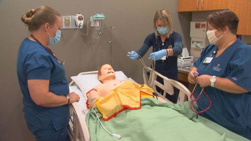 Students enrolled in the nursing program at NWTC Marinette work in a skills lab.