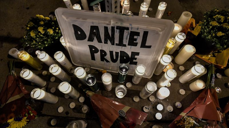 In this Sept. 2, 2020, file photo, candles light a makeshift memorial for Daniel Prude, a Black...