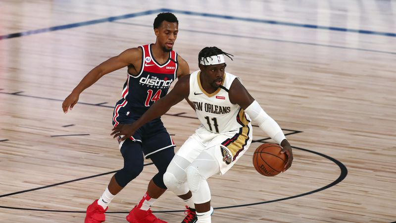 New Orleans Pelicans guard Jrue Holiday (11) handles the ball against Washington Wizards guard...