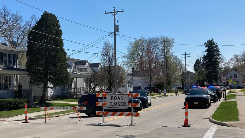 Green Bay police barricade the 100-block of Gray Street while they investigate a reported...