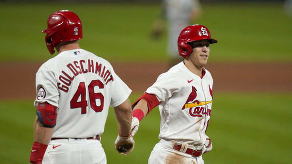 St. Louis Cardinals' Tommy Edman, right, is congratulated by teammate Paul Goldschmidt (46) after hitting a two-run home run during the fifth inning in the second game of a baseball doubleheader against the Milwaukee Brewers Friday, Sept. 25, 2020, in St. Louis. (AP Photo/Jeff Roberson)