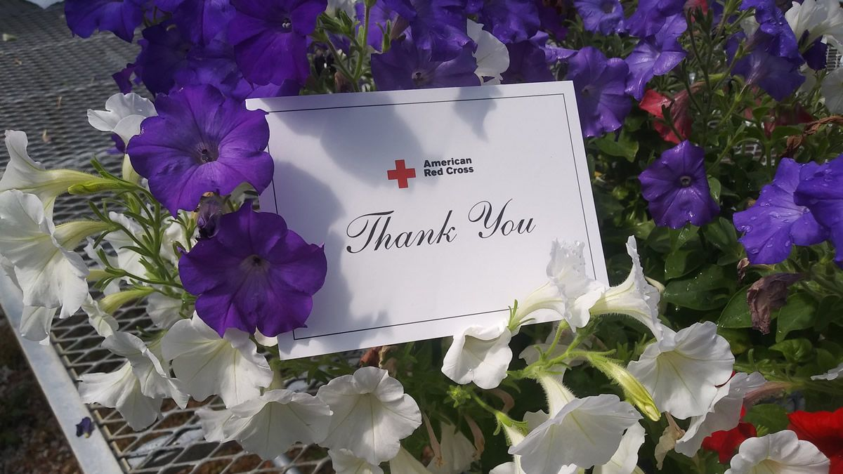 Green Bay Preble High School's FFA students gave flowers to the American Red Cross to thank volunteers (Photo: Green Bay Area Public School District)