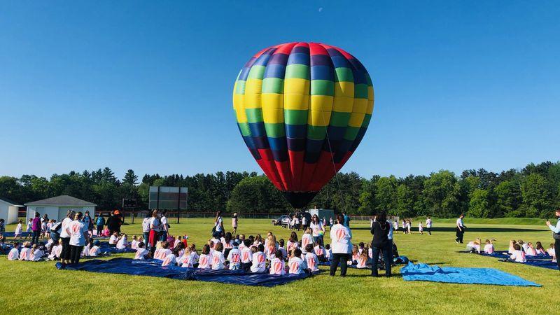 A hot air balloon prepares to fly a Wautoma elementary school principal away.