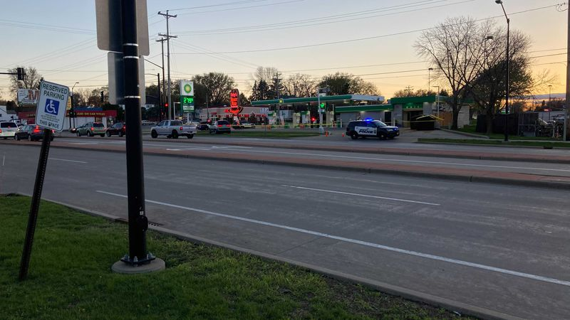 Crime scene tape surrounds a BP gas station near the intersection of Military and Mason Street...
