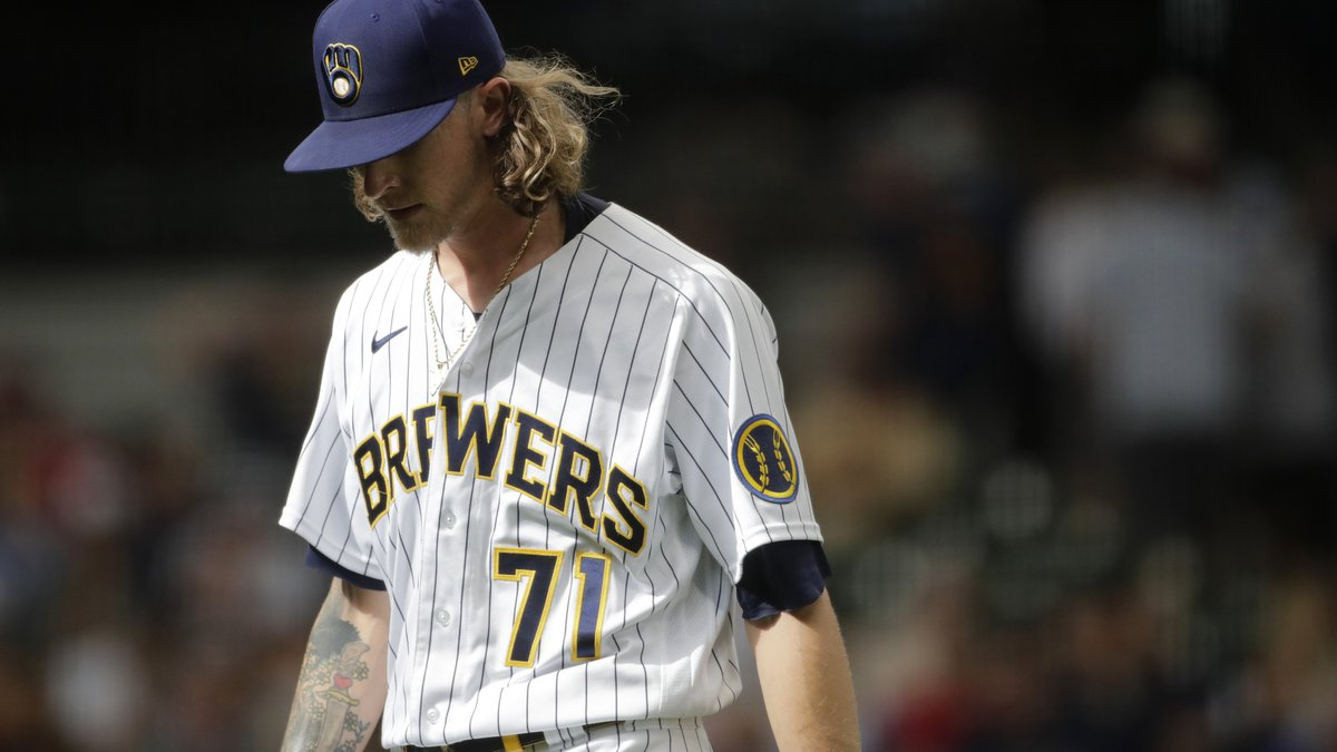 Milwaukee Brewers' Josh Hader walks to the dugout after being taken out of the game during the...
