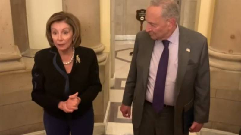 House Speaker Nancy Pelosi is seen alongside Senate Majority Leader Chuck Schumer in this file...