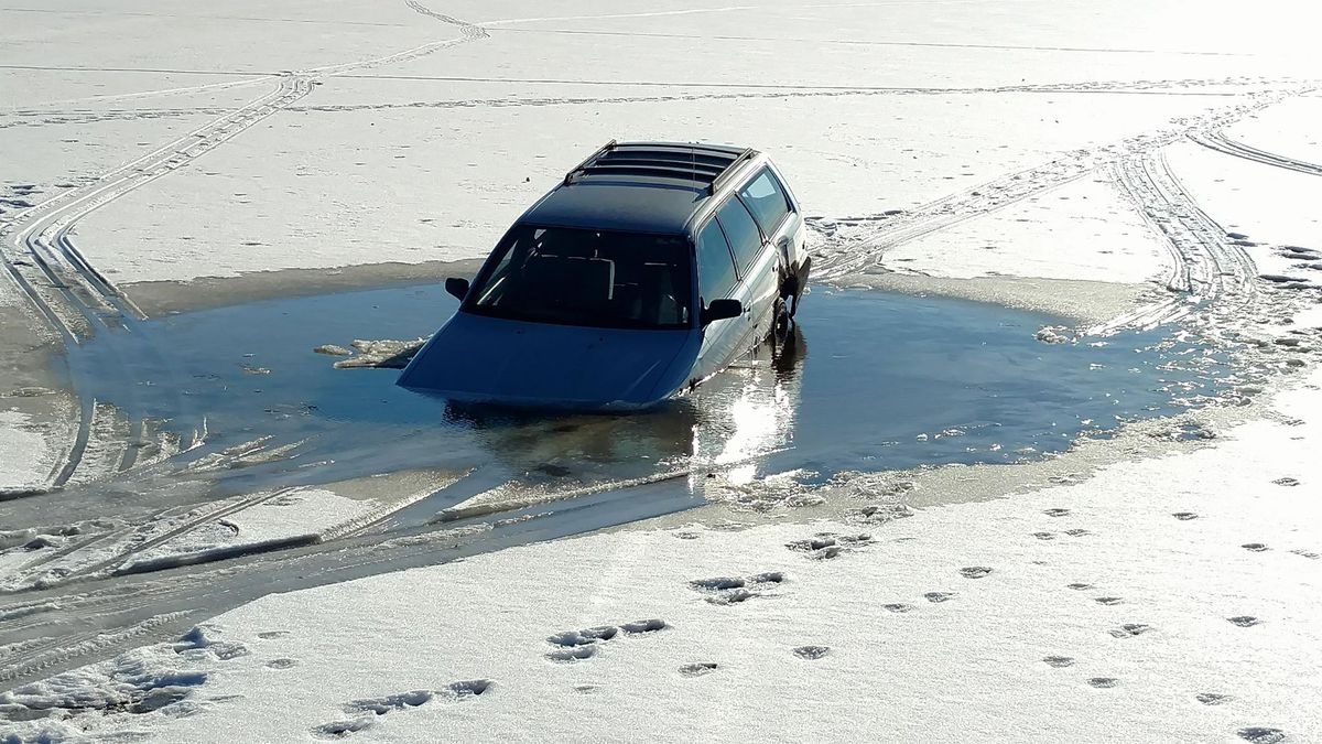 SUV partially submerged in open water in the ice on Lake Butte des Morts on Dec. 19, 2017...