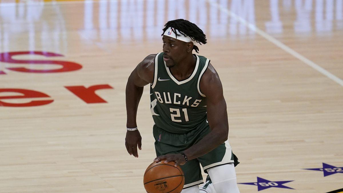 Milwaukee Bucks guard Jrue Holiday (21) controls the ball during an NBA basketball game against...