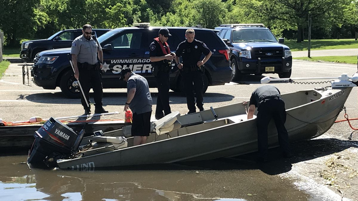 Crews pull fishing boat from Lake Butte des Morts. June 3, 2020. (WBAY Photo)