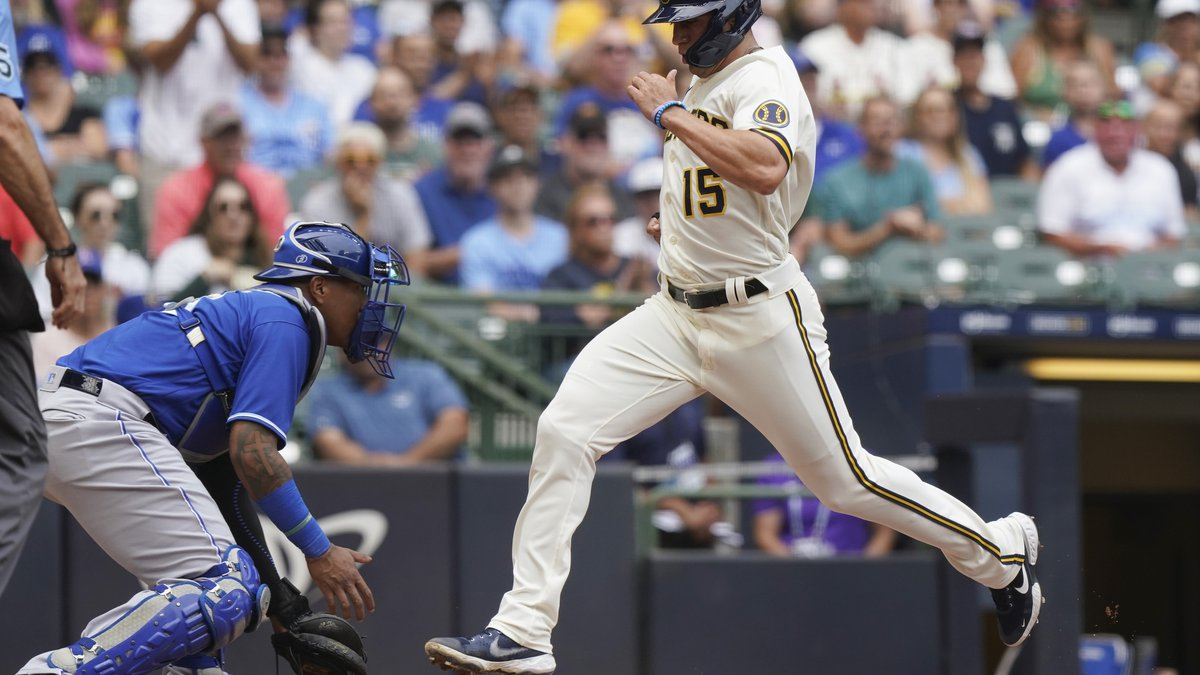 Milwaukee Brewers' Tyrone Taylor, right, scores on a two-run single by Manny Pina as Kansas...