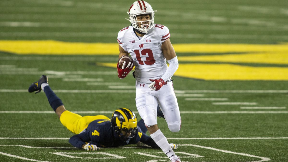 Wisconsin wide receiver Chimere Dike (13) gets away from Michigan defensive back Vincent Gray...
