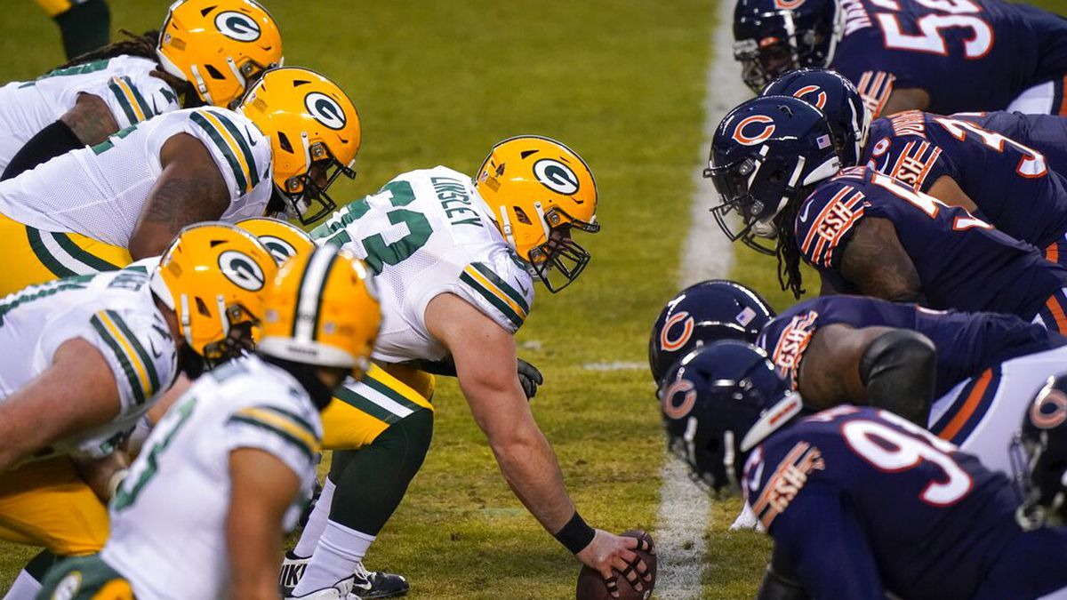Green Bay Packers' Corey Linsley snaps the ball during the first half of an NFL football game...