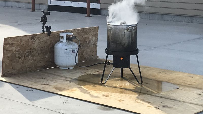 A turkey fryer smokes during a demonstration on how not to fry a turkey.