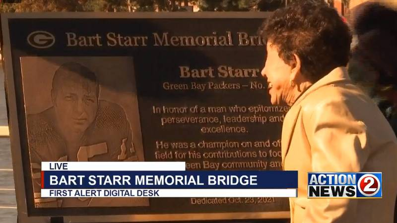 Cherry Starr admires the plaque for the Bart Starr Memorial Bridge in Green Bay.