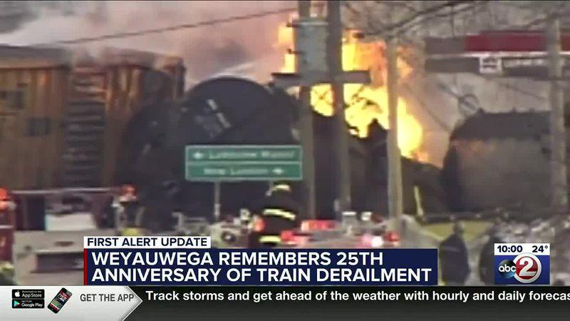 Train cars burn after the derailment in Weyauwega in March, 1996