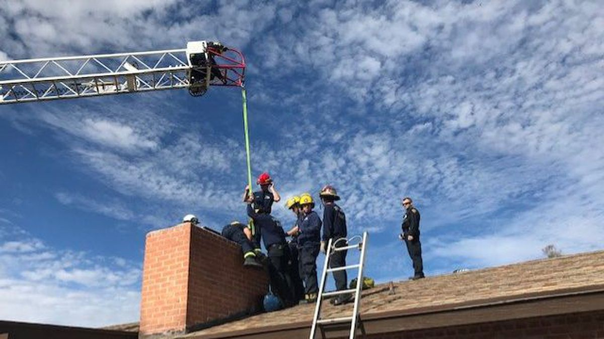 """Firefighters had to pull him from above with a crane and push him from below before """"up the chimney he rose."""" (Source: Tucson Fire Department)"""