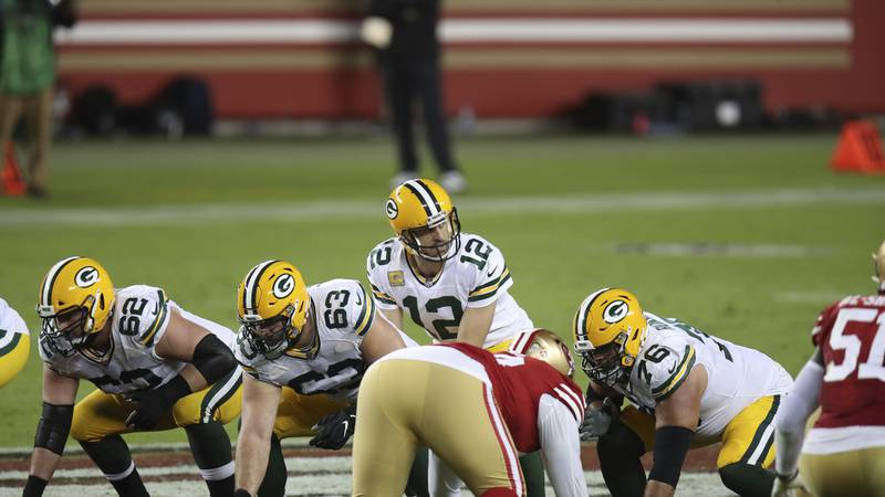 Green Bay Packers starting quarterback Aaron Rodgers (12) calls a play during an NFL football...