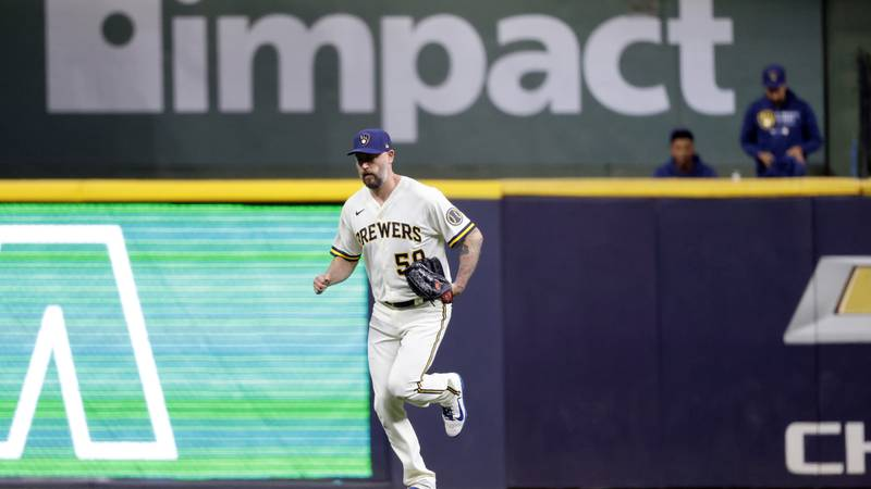 Milwaukee Brewers' John Axford enters a baseball game against the Pittsburgh Pirates during the...