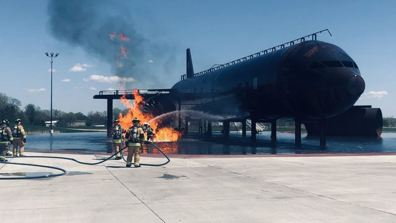 Crews work to put out a fire at ATW ARFF Training Center.