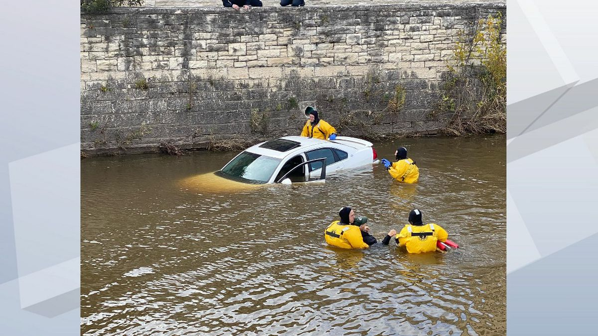 Fond du Lac Fire and Rescue workers rescue two people from a vehicle in the Fond du Lac River...
