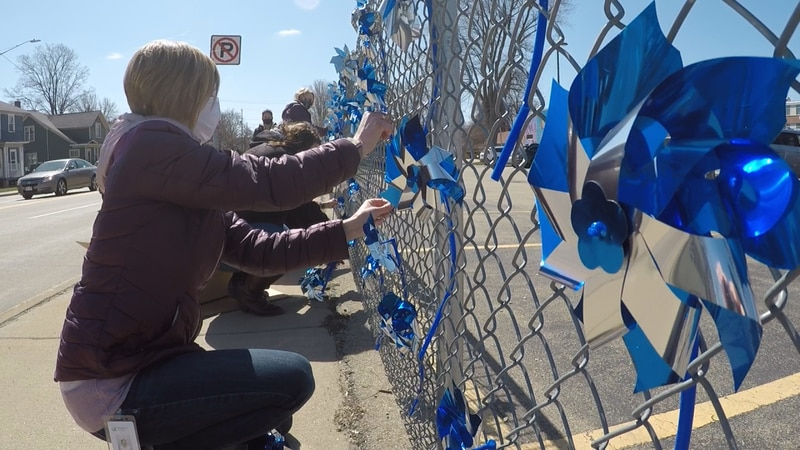 Pinwheels being placed outside Harbor House.