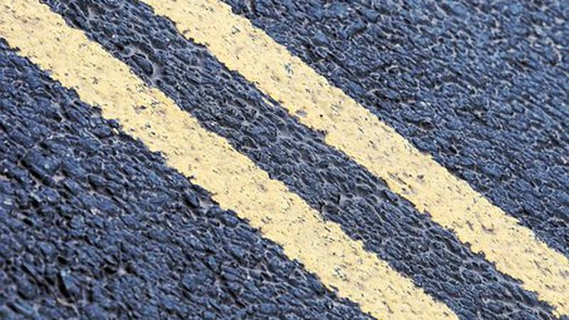 Oshkosh's Jackson Street will be reduced from four lanes to one lane in each direction with a...