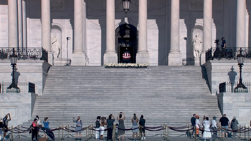 Public pays final respects to Rep. John Lewis Tuesday outside the Capitol.