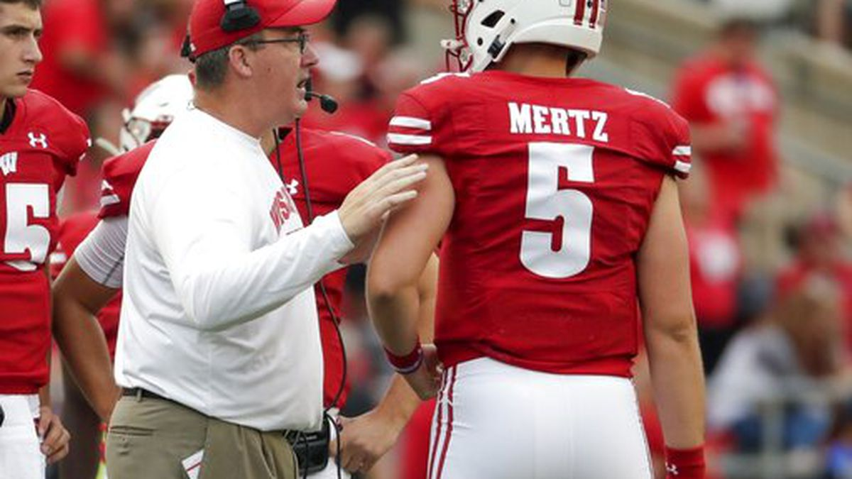 Wisconsin head coach Paul Chryst talks to quarterback Graham Mertz during the second half of an NCAA college football game against Central Michigan Saturday, Sept. 7, 2019, in Madison, Wis. (AP Photo/Morry Gash)