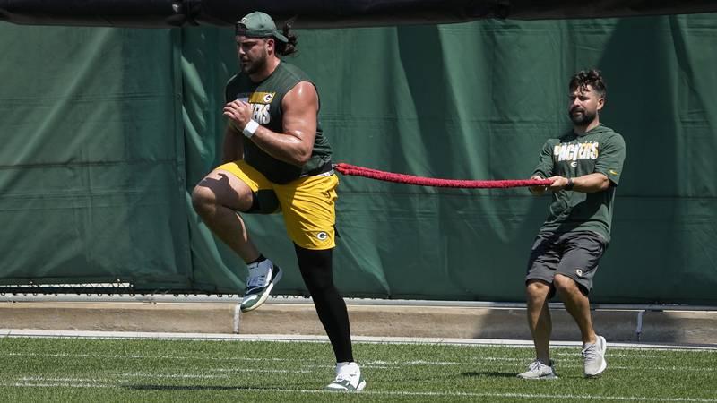 Green Bay Packers' David Bakhtiari runs a drill during an NFL football minicamp Tuesday, June...
