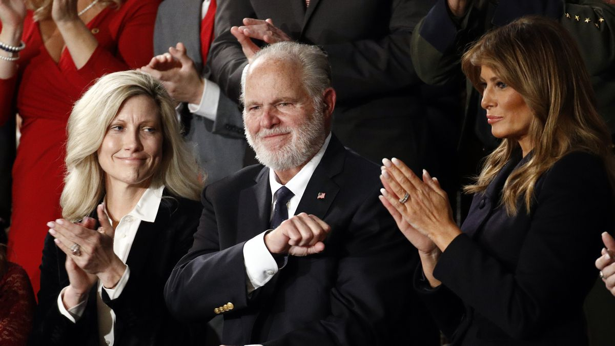Rush Limbaugh reacts as first Lady Melania Trump, and his wife Kathryn, applaud, as President...