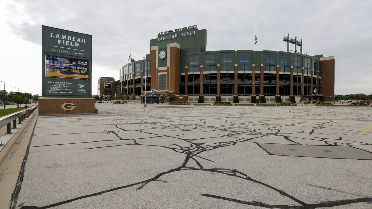 The parking lot outside Lambeau Field is empty before an NFL football game between the Green Bay Packers and the Detroit Lions Sunday, Sept. 20, 2020, in Green Bay, Wis. (AP Photo/Mike Roemer)