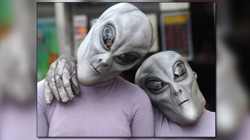 Aliens pose in front of Traditions on Main Street in downtown Roswell, N.M., Thursday, July 3,...