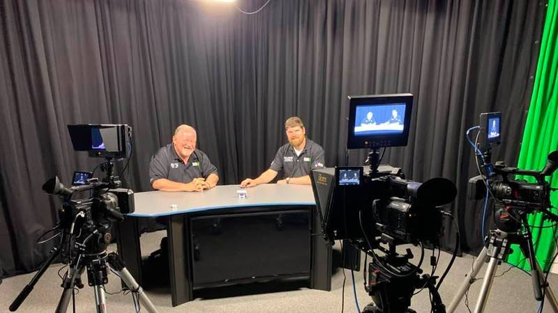 """Veterans Mike Hert and Adam Alexander sit on the set of their new show, """"The Outpost""""."""