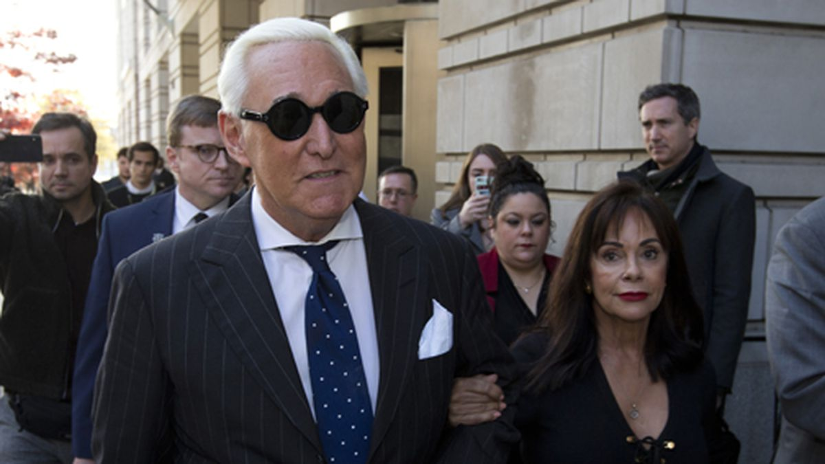 In this Nov. 15, 2019 file photo, Roger Stone, left, with his wife Nydia Stone, leaves federal court in Washington, Friday, Nov. 15, 2019. (AP Photo/Jose Luis Magana, File)