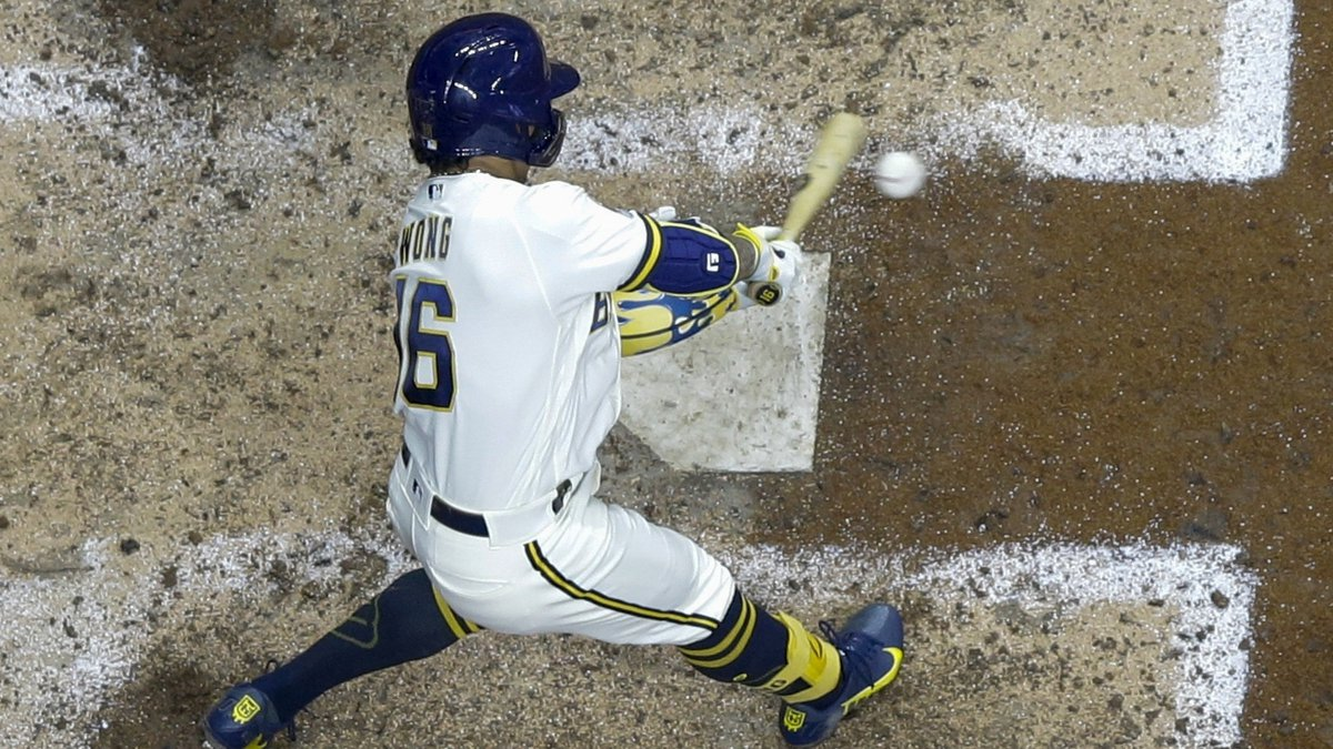 Milwaukee Brewers' Kolten Wong hits a two-run scoring single during the sixth inning of a...