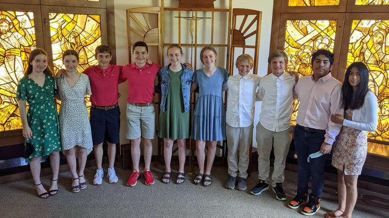 Five sets of twins make up almost half of this year's graduating 8th grade class at Father...