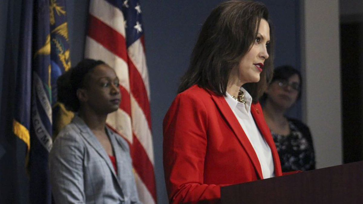 In a pool photo provided by the Michigan Office of the Governor, Michigan Gov. Gretchen Whitmer addresses the state during a speech in Lansing, Mich., Wednesday, April 22, 2020.  (Michigan Office of the Governor via AP, Pool)