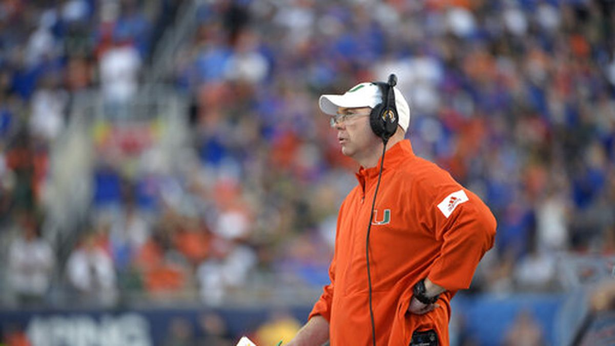 Miami offensive line coach Butch Barry works from the sideline during the first half of an NCAA college football game against Florida Saturday, Aug. 24, 2019, in Orlando, Fla. (AP Photo/Phelan M. Ebenhack)