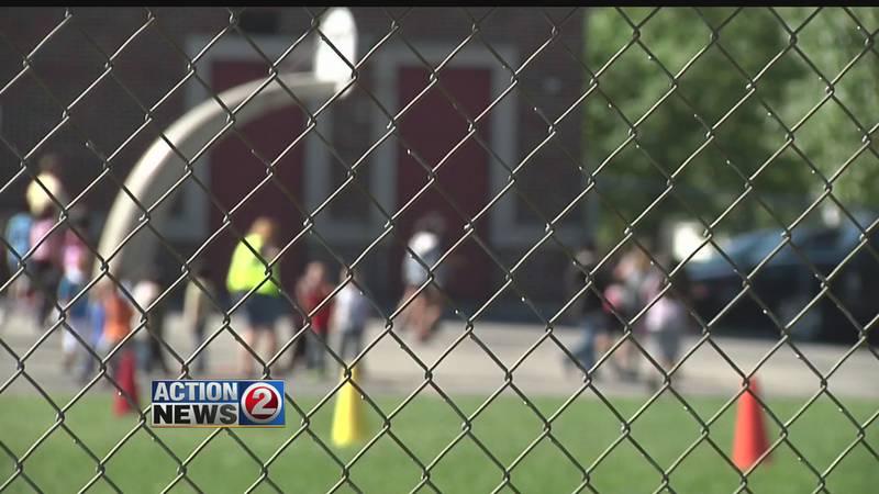 School playground behind fence (WBAY file photo)