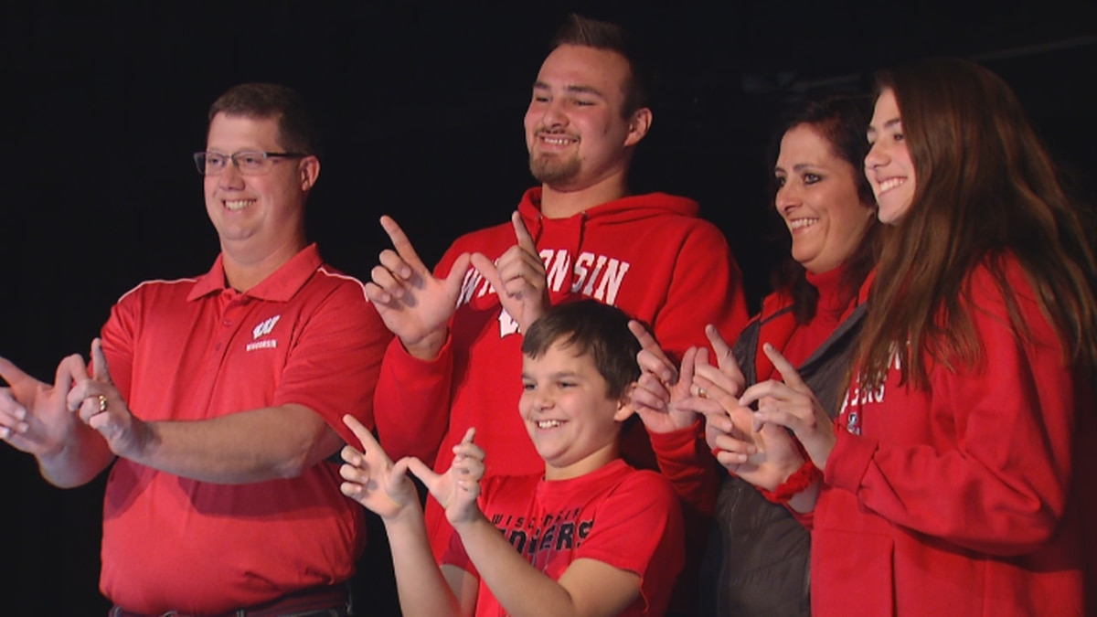 Kewaunee senior Tanor Bortolini (second from left) officially joins Wisconsin Badgers football...