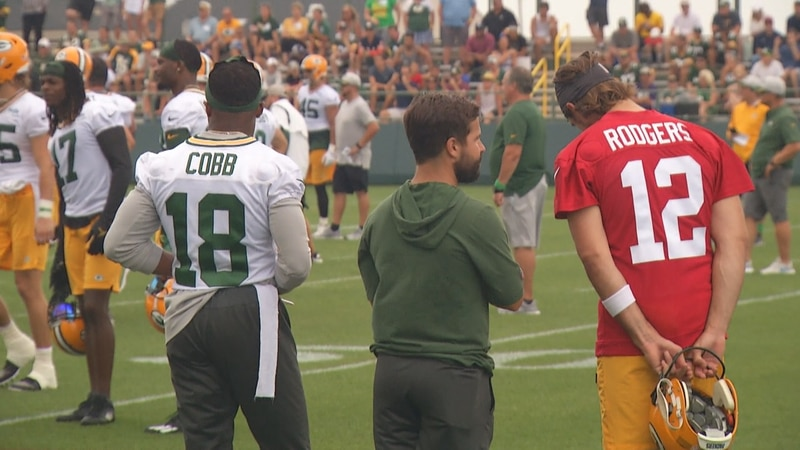 Randall Cobb stand next to Green Bay Packers quarterback Aaron Rodgers during Thursday, July...