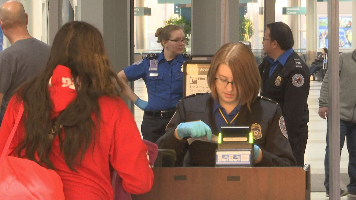 TSA workers screen flyers through Green Bay Austin Straubel International Airport (WBAY photo)