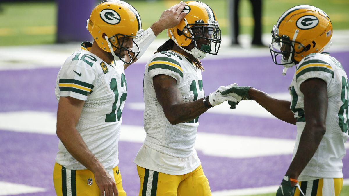 Green Bay Packers wide receiver Davante Adams, center, celebrates with teammates Aaron Rodgers,...