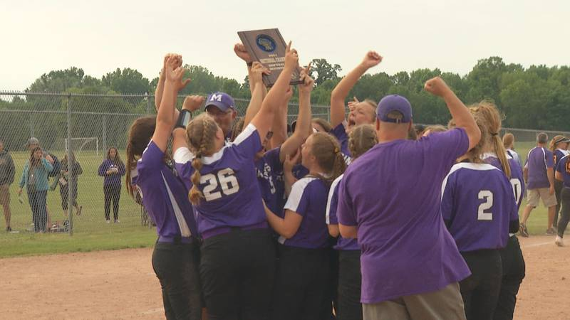 The Marinette Marines softball team celebrates after defeating Denmark 5-4 in the WIAA Division...